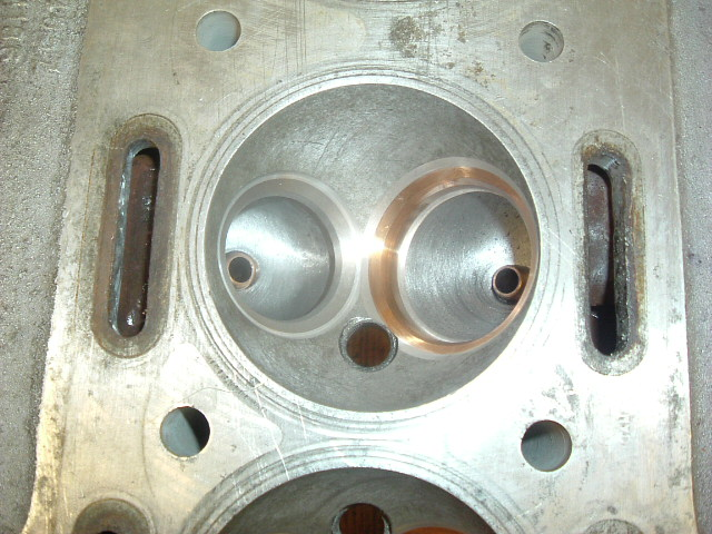 closeup of Serdi machined inserts prior to final precision grind and corrective porting.jpg